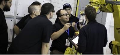 Markesino instructing robot programers